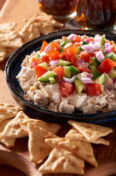 Score big by bringing this Chicken Shawarma Dip, served with WHEAT THINS Toasted Pita Original Oven Baked Crackers.