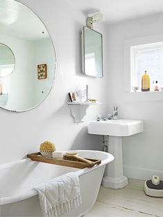 Antique Fixtures - The master bath inside this historic home (which used to be a 19th-century blacksmith shop), retains many of its century-old fixtures, including the tub, sink, and medicine cabinet.  A pedestal shelf creates space for toiletries.