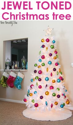 Gorgeous white Christmas tree with jewel toned ornaments!