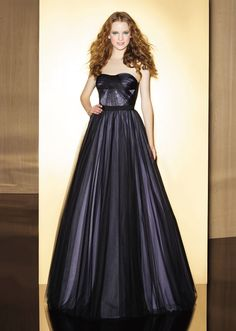 This darling soft tulle ball gown from Love 16soft sweetheart neckline with ribbon at natural waist on pleated A-line skirt and corset back.