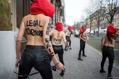 The King is Dead! Long Live the King!  PAGE 3 NEWS: Femen stand in front of the Saudi embassy in Paris for Raif Badawi