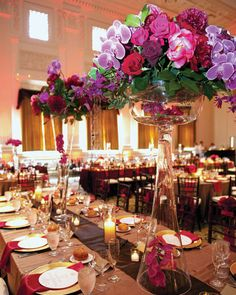 Tall Centerpiece Ideas: Black Magic roses, Black Baccarat roses, coral and red peonies, and fuchsia orchids.