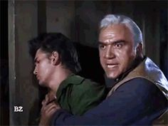 """Ben argues with bandits while holding an injured Little Joe (Lorne Greene; Michael Landon; """"The Deadly Ones"""", S04E10, 1962)"""