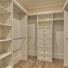 Would love to have all my bedroom closets redone like this.  transitional closet by Spinnaker Development