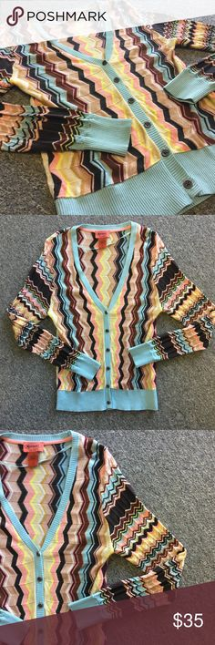 """Missoni for Target Sweater   NWOT Missoni for target. Brand new without tags. Beautiful signature Missoni chevron pattern. Beautifully made sweater. V-neck and buttons down the front. Lightweight, comfy sweater. Measurements laid flat: B: 16"""", W: 15"""", L: 24"""". Size medium. Missoni Sweaters Cardigans"""