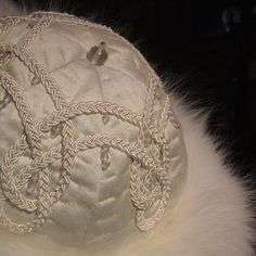 Tone on tone Imperial, 2015.  Egyptian cotton crown with hand braided soutache passementerie, clear bead accents and fox fur cuff.  All materials are recycled.