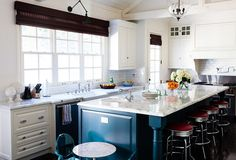 A deep-blue island, which might make another room appear too dark, works in this light-filled kitchen.