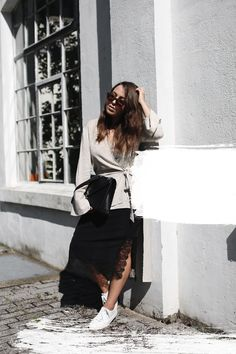 A DESIGN CLASSIC | Fiona from thedashingrider.com wears a nude Zara tunic, a black H&M midi skirt, White sneakers, a Movado Esperanza Museum watch and s black Saint Laurent Cassandre Bag | Petite Blogger | Style Blogger | Outfit