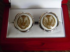 These absolutely incredible Royal Copenhagen cufflinks feature an exceedingly rare depiction of a Tiger set in RC signature porcelain, set in a