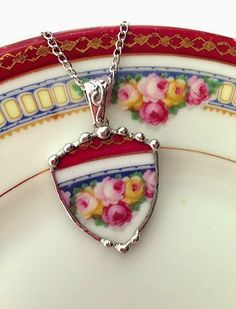 This would be great if you had some heirloom china that breaks too! Broken china jewelry necklace pendant rose shield shaped by dishfunctionldesigns Jewelry Crafts, Jewelry Art, Vintage Jewelry, Fine Jewelry, Fashion Jewelry, Gold Jewellery, Ceramic Jewelry, Glass Jewelry, Pendant Jewelry
