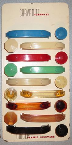 vintage kitchen cabinets - Google Search  Somewhere in my stuff I have some red bakelite handles. I just LOVE these. You could mix and match on a dresser!!!