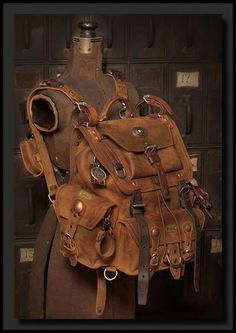 Kustom to da max! Saddleback Leather Co. Front Pocket backpack with tons of vintage Swiss Army bits, patina, brass, copper and the most. Viktorianischer Steampunk, Steampunk Fashion, Backpack Bags, Leather Backpack, Leather Bags, Camera Backpack, Survival, Leather Projects, Leather Accessories