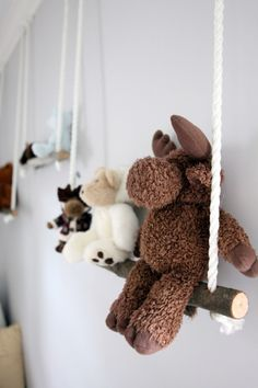 Homemade branch swings for stuffed animals.