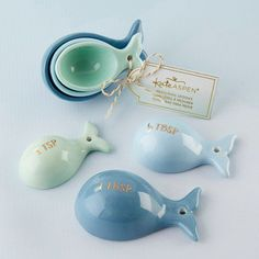 Treat your nautical wedding guests to these adorable ceramic whale measuring spoons.