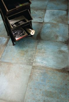 Trace by @ceramichecaesar. Porcelain stoneware wall/floor tiles with an oxidized copper effect