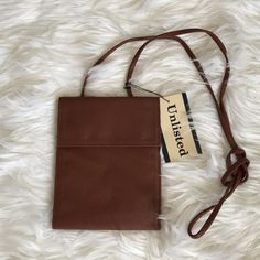 """🎀Total Trendsetter HP!🎀Reduced🎀 Kenneth Cole Unlisted hanging wallet.  Closed measures 7"""" X 5.5"""".  Great for travel!  Credit card slots, ID window,, lots of pockets.  1 large zippered pocket inside & outside.  Snaps close.  Long shoulder strap so it can be worn as s cross body bag!  Vegan!💟 Unlisted Bags Travel Bags"""