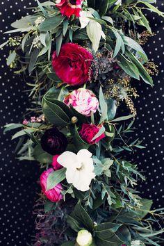 Black & Gold NYE Wedding: Jewel toned floral garland by Celsia Floral.