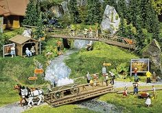 we don't have real Trains but H0 Scale Model Train Scenery like Model Trees, Model Lamps, Model Cars and Model Figures for Model Trains