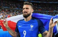 Olivier Giroud of France celebrates his team's 5-2 win after the UEFA EURO 2016 quarter final match between France and Iceland at Stade de France on July 3, 2016 in Paris, France.
