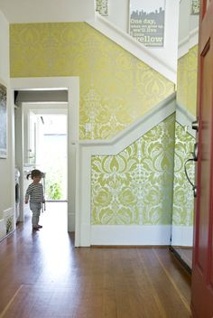 Transition the wallpaper, different color or shade on the top of the staircase and the upstairs hall than the entry way? In a silvery pattern for my house.