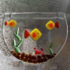 Dress up your window or wall with an aquarium filled with fish you never have to feed. :)