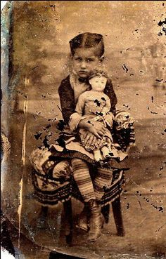 Girl with doll- and wild tights. - Turn of the Century Antiques