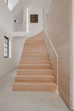 wood stairs meeting concrete floor