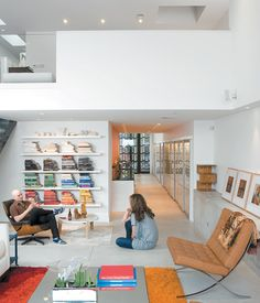 Hernandez and Surratt relax in the living room, which is enlivened by the house's internal topography. A short flight of steps divides th...