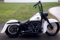 """2002 Harley FatBoy 2"""" Arlen Ness Slam Kit w/ Drop Kick Stand, Black Powder Coated 60 Spoke Twisted Spoke Wheels, 18"""" Rear Wheel, 21"""" Front, Le Pera Seat, Klock Werks Bench Mark 21"""" Front Fender, Bench Mark Smooth 4"""" Stretched Rear Fender, Harley Davidson Freight Train Head Light Nacelle, Carlinni 16"""" Tall 1.5"""" Ape Hangers w/ High Roller Risers, Gloss Black Powder Coated everything Denim White Powder Coated Tins, Vance & Hines Short Shots, Kuryakyn Curved Side Mount Plate with LED tail lig"""