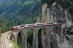 Landwasser Viaduct. 196 viaducts and bridges and 55 tunnels. Passes Lake Zurich, glaciers, and Bernina Massif.