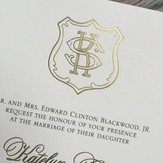 Gold foil custom monogram crest for wedding invitations