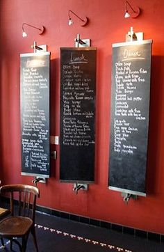 Swiveling Mounted Chalkboards at Bistro Vida, via here.    A vintage carnival wheel and chalkboards are unique accessories to this countr...