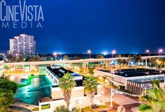 Downtown Fort Myers, FL - Series 1 by CineVistaMedia. This original photo is from downtown Fort Myers, FL looking west towards Centennial Park. The high-rise building on the left is High Point Place.