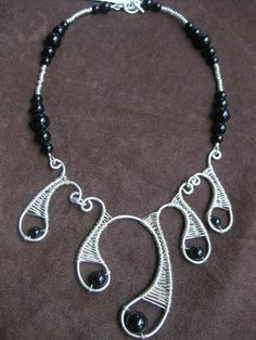 Onyx with Silver Paisley Wire Work Necklace - SHIPPING INCLUDED. $113.00, via Etsy.