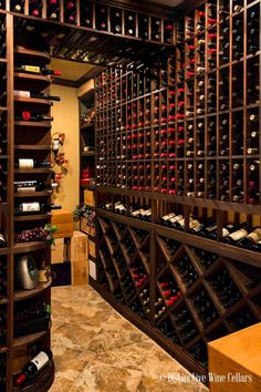 Wine on nearly every side! There are so many options when it comes to designing your wine room. Let us help you create a Custom Wine Cellar designed to match your wine and lifestyle. | Ultimate Closet Systems | Wine | Wine Bottles | Wine Cellar | Wine Roo