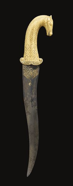 A MUGHAL CARVED IVORY HORSE-HEAD HILTED DAGGER, INDIA, 18TH CENTURY