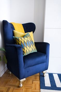 Image above: One of our absolute favorite pieces in the apartment is this blue chair. Our apartment building is a large high-rise, and on occasion, we have been able to find treasures out of other people's trash. We found the bones of this chair with a tattered fabric in the trash. We had a vision to reupholster it in a luxurious blue velvet. We also knew we wanted the chair high off the ground, so we bought these wooden legs and painted them to match the feel we were going for.