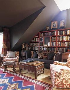 Designer Amanda Kyser has filled Long Island home's library with artistic details. The Molina sofa from Bespoke is covered in Arabica Belgian linen from Libeco-Lagae, and the pillows are a mix of antique silk ikat and 19th-century Thai patterns. Walls are painted Dark Taupe and bookcases are Merlot, both by Benjamin Moore.  Pictures of Home Library Decor - House Beautiful
