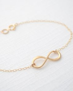 Gold Infinity Bracelet by Olive Yew. A beautiful infinity bracelet makes the perfect holiday gift for a loved one. Also available in rose gold and silver.