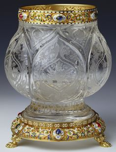Rock crystal vase by Mikhail Evlampievich Perkhin for Faberge circa 1903. Rock crystal, gold, enamel, cabochon rubies, emeralds and sapphires.