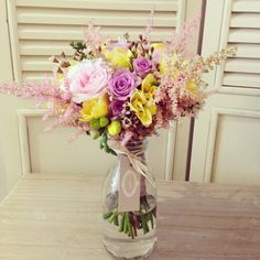 Astilb freesia and roses bouquet