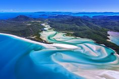 Paradise found: an aerial view over Whitehaven Beach in Queenland's Whitsunday Islands, AUSTRALIA. Image by Yoshio Tomii / Getty Images