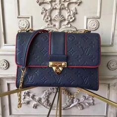 Louis Vuitton M43394 Saint Sulpice PM Monogram Empreinte Leather Marine  Rouge Louis Vuitton Handbags, Purses 44a29cda720