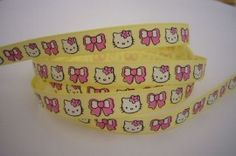 Hello Kitty band GEEL / ROZE € 0,85 p.m