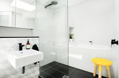 Different take on tiles + Black faucets are so nice. Scandinavian Bathroom by Touch Interiors