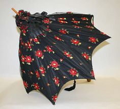 Black floral silk parasol with wood handle, by Tiffany & Co., American, 1890s.