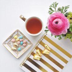 Monday morning motivation courtesy of lots and lots of Easter treats!  . . . . #MondayMotivation #Easter #minieggs #flatlay #golden #tea #indigofaves #sugarpaper #pinkflowers #ranunculus #cadburyminieggs #gold #monday #goodmorning #flatlay #bunnies #easterbunny #prettyflatlay #prettyinpink #eastermonday by stylecalling