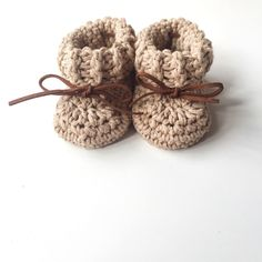 Handmade from cotton yarn, these stunning crochet baby booties are available in either a solid colour or contrasting colours. Organic Cotton Yarn, Cotton Gifts, Crochet Baby Booties, New Baby Gifts, The Fool, Hand Stamped, Baby Items, Baby Shower Gifts, New Baby Products