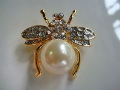 Bee Pin- would wear with a cluster of pearl necklaces!