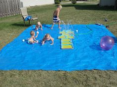 "Homemade splash pad in the backyard. Brilliant for my yard which is not ""run through the sprinkler with bare feet"" quality."
